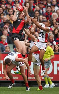 Joe Daniher flies high for one of his 13 marks